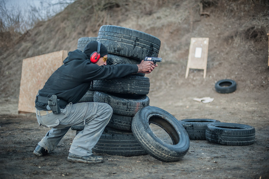 Combat gun shooting training from behind and around cover or barricade. Advanced fighting