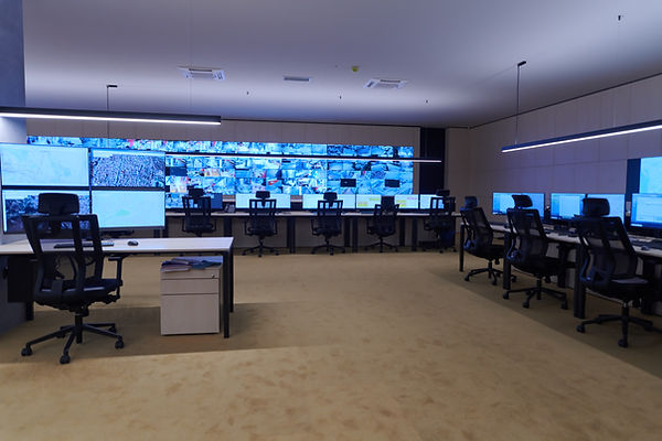 Empty interior of big modern security system control room, workstation with multiple displ