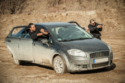 Police agent and bodyguard training action gun shooting from car