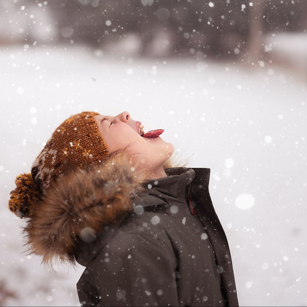 Boy catching snow on his tongue Spruce Grove Alberta
