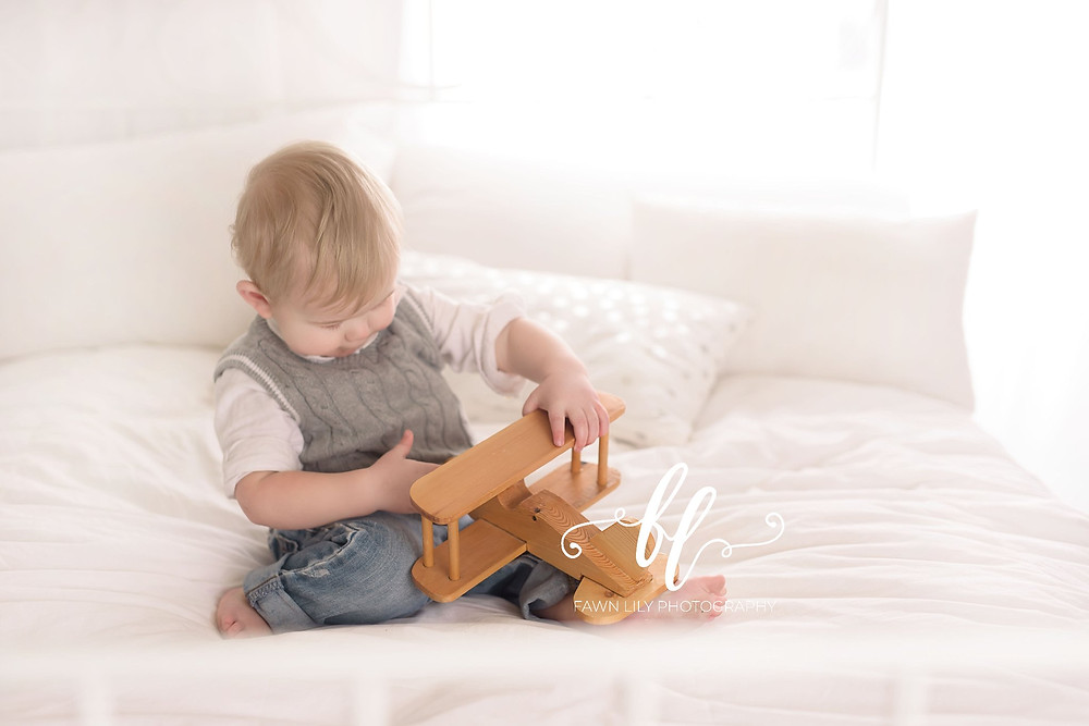 baby on a bed, airplane toy, victoria bc family photographer, sidney bc, how to plan a wall gallery of family photos.