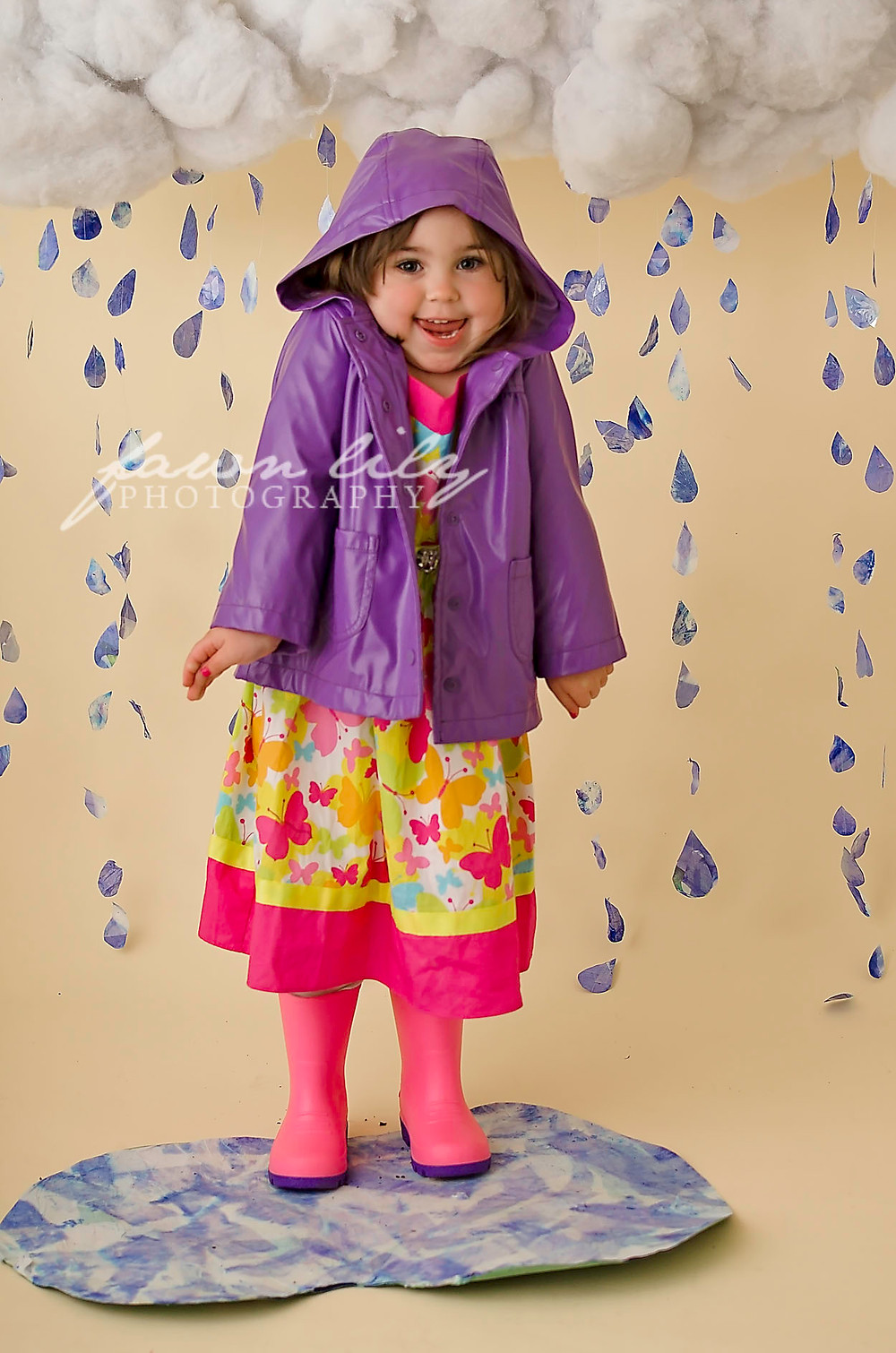Beautiful Peyton being silly in the raindrops at Fawn Lily Photography's Spring Minis