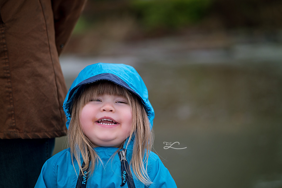 Toddler in a Muddy Buddy Smiling, Fawn Lily Photography, Sidney BC Family Photographer, Tofino BC