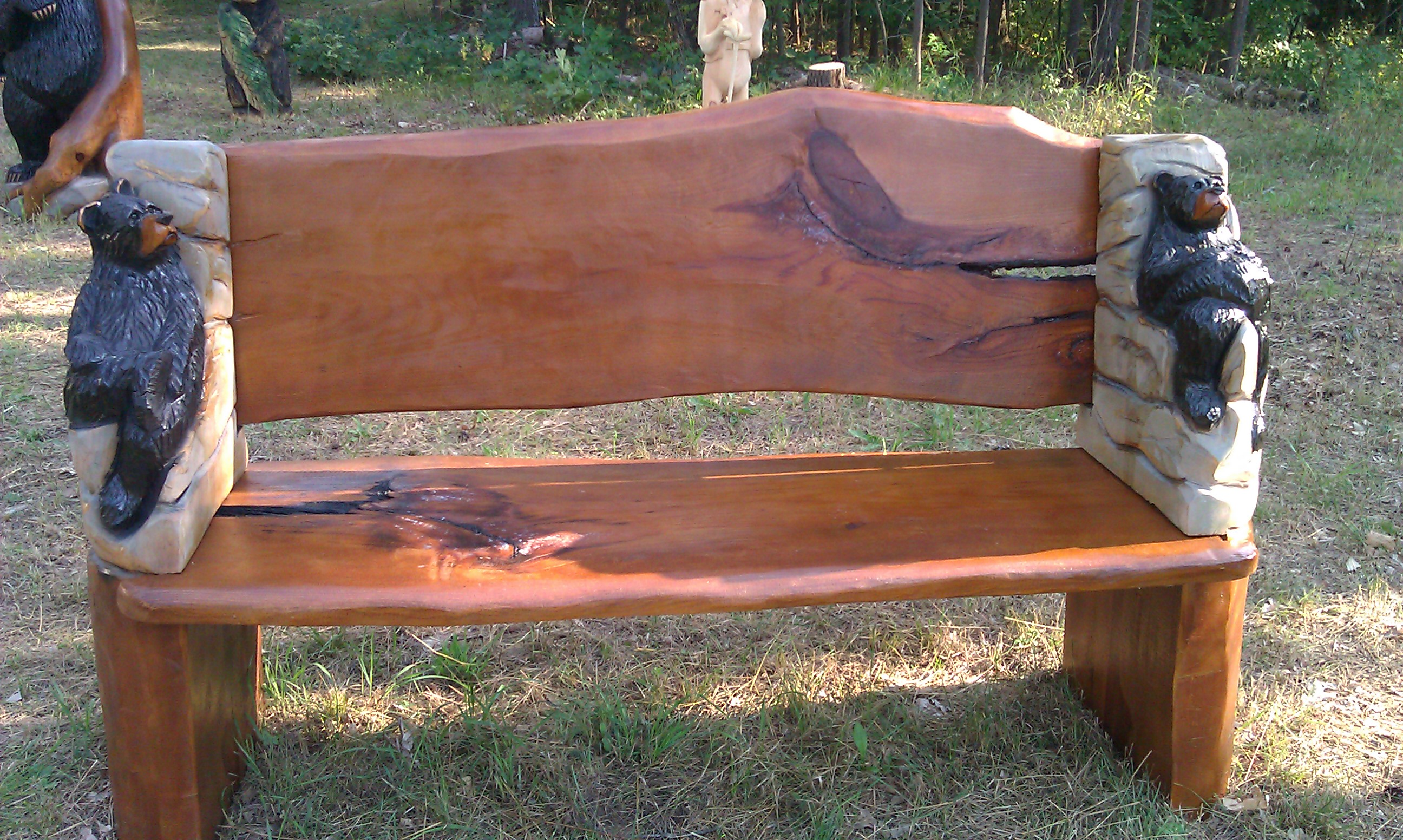 Alonzo Montoya Chainsaw Carved Bench 2.jpg