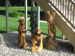 chainsaw carving bears pine trees