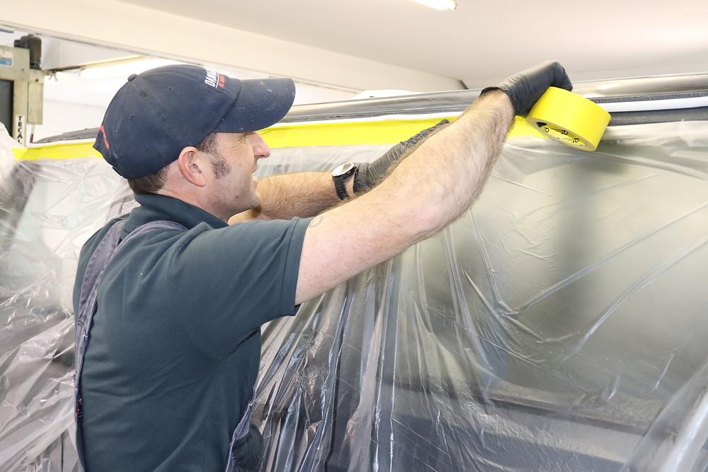 Wayne masking a car ready for paint