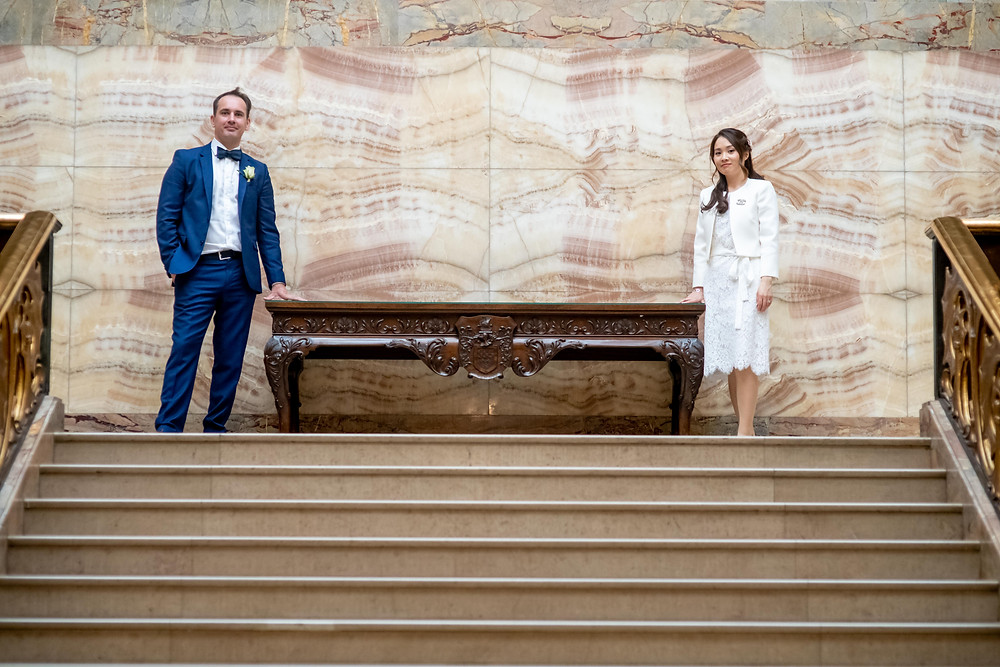 Bride and Groom at top of ornate staircase