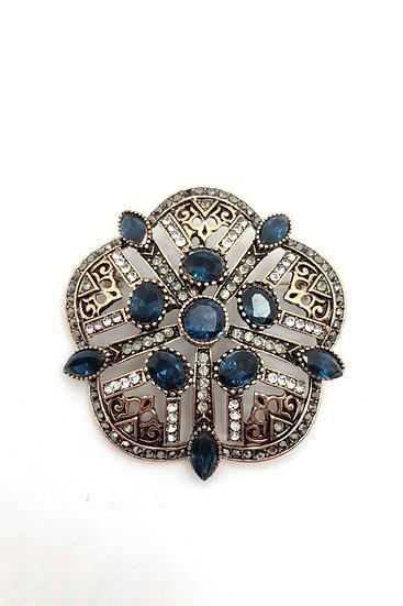 Pendente- spilla in bronzo,  pietre sintetiche blu e strass.