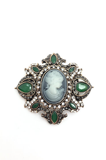Pendant-brooch in bronze, green synthetic stones, rhinestones and resin cameo