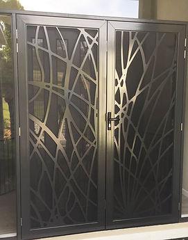Decoview lasercut aluminium security door reeds design