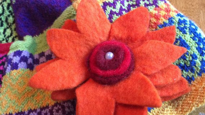 Mulit-colored Winter hat with Orange wool flower
