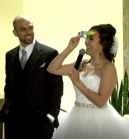 Yes, that is me and my husband at our wedding reception. And yes, I did do an optics demonstration with prism diffraction grating glasses. Yes, each of our guests got prism diffraction grating glasses as their wedding favor. Cool, huh??
