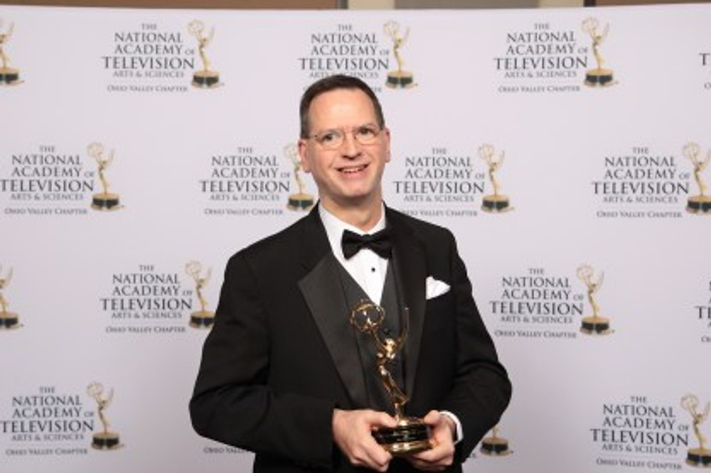 """Doug with his Emmy for producing special events coverage for """"A Life Well Lived: Lauren Hill's Memorial Service"""" in 2016."""