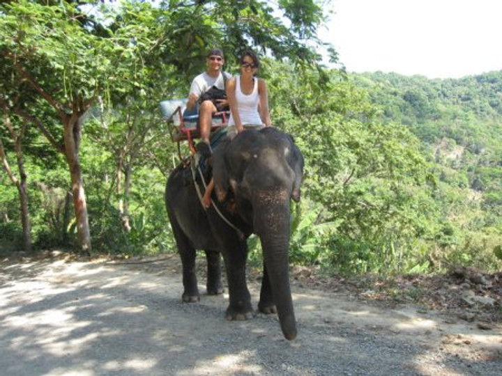 Riding an elephant with Rick in Thailand.