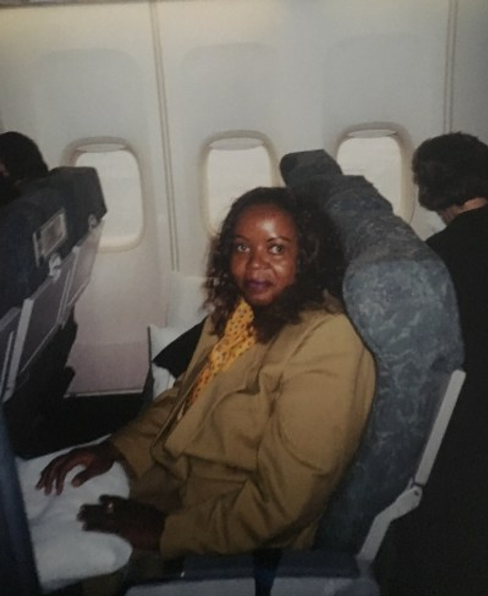 On a plane ride to Canada to visit my dear son and daughter, 2002.