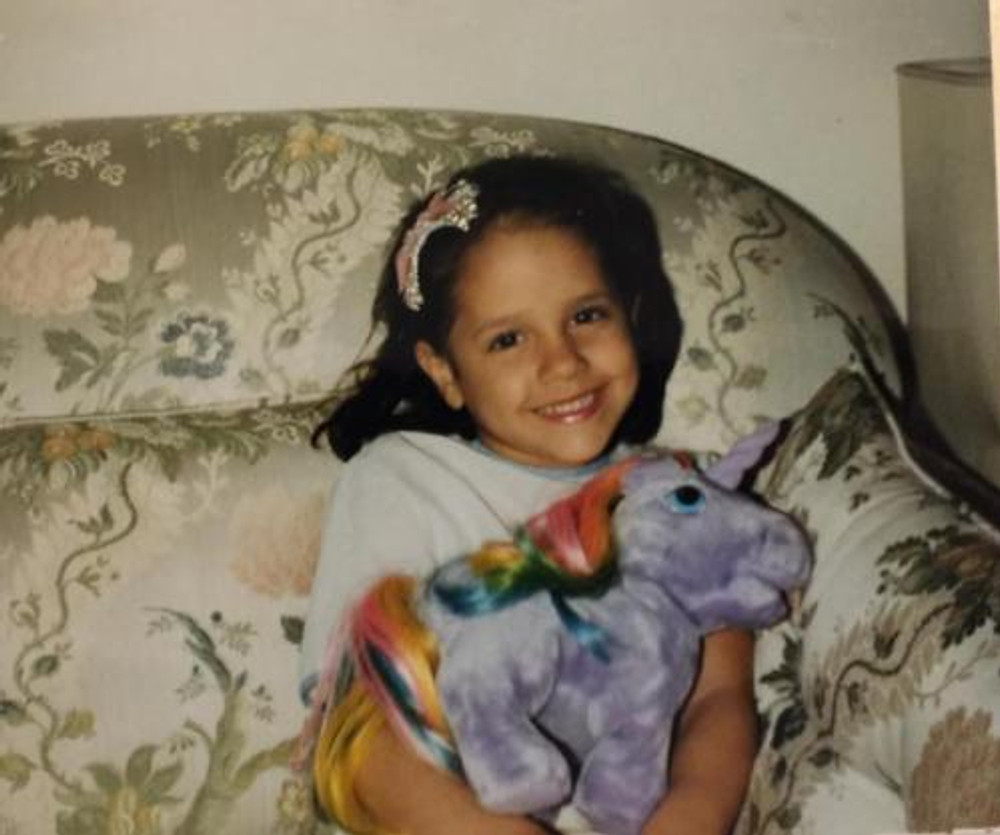 Little me, with one of my favorite toys. It's a horse, of course!