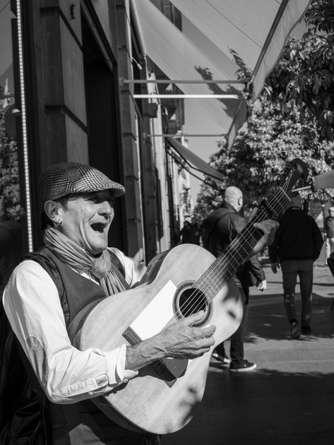 man-playing-acoustic-guitar-in-the-stree