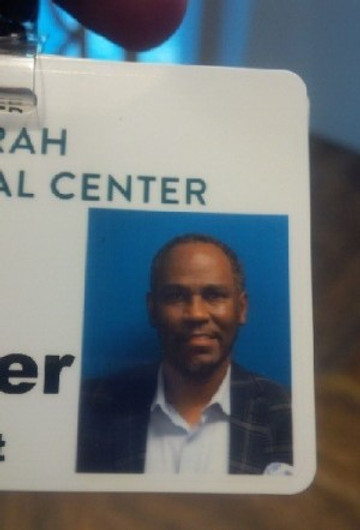 My badge from work at the medical center.