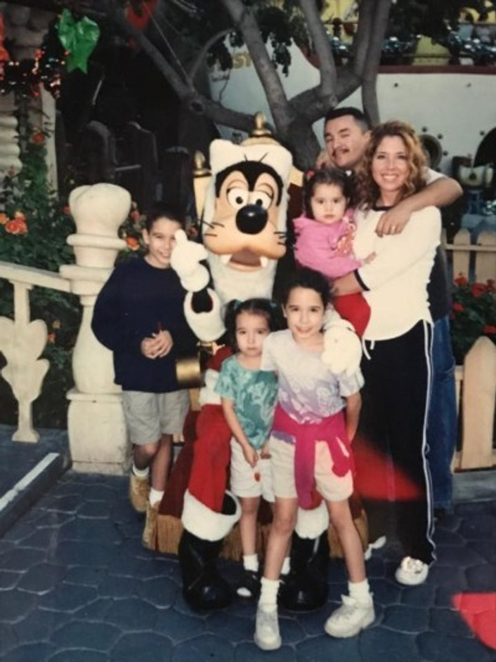 My family at Disneyland 2001. I'm in the blue shirt.