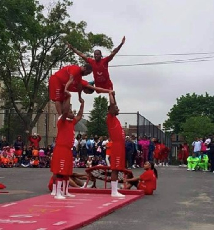 Performing at a tumbling show with my team (I'm flying over).