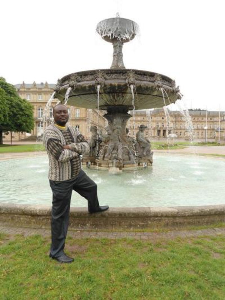 Me posing in front of a fountain abroad.