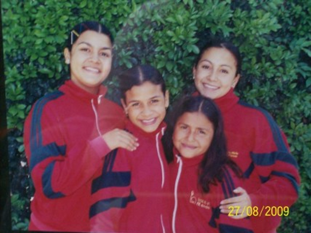 With my sisters (I'm on the top right), 2009.