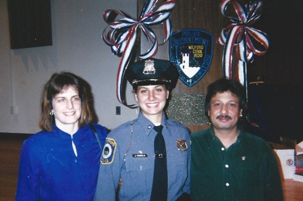 With my parents at my graduation from the police academy, 2001.