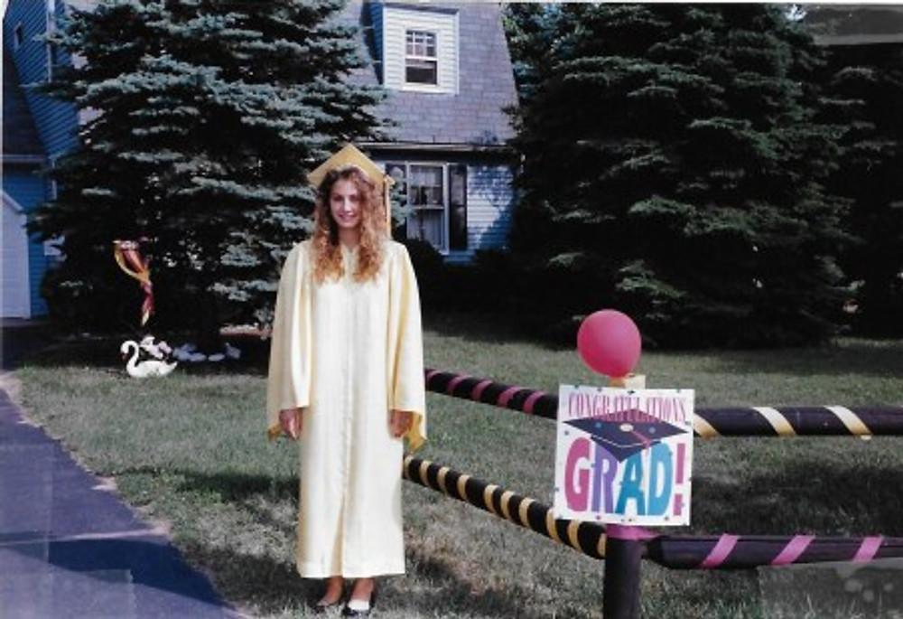 In my high school graduation gown, 1994.