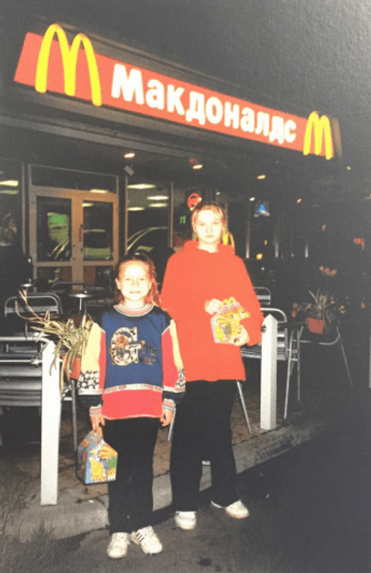 With my little sister in front of McDonald's.