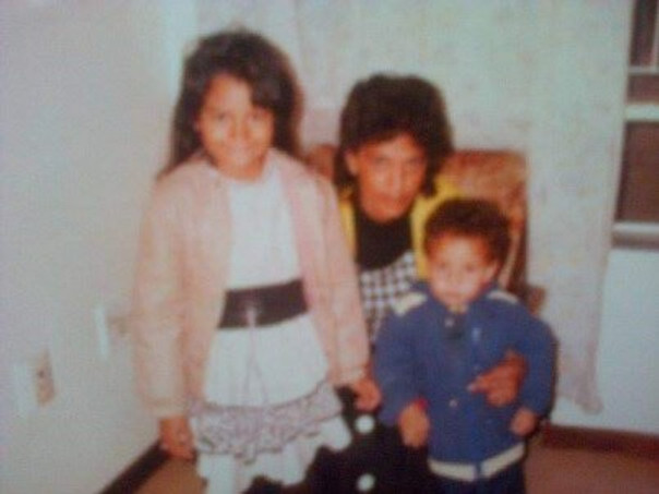 With my mom and my little brother, 1991.
