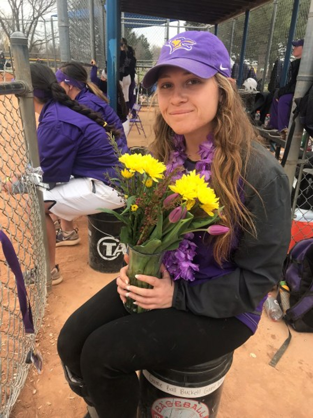 "Here I am on the day of my ""senior night"" for softball. While I couldn't play, we still celebrated my career."