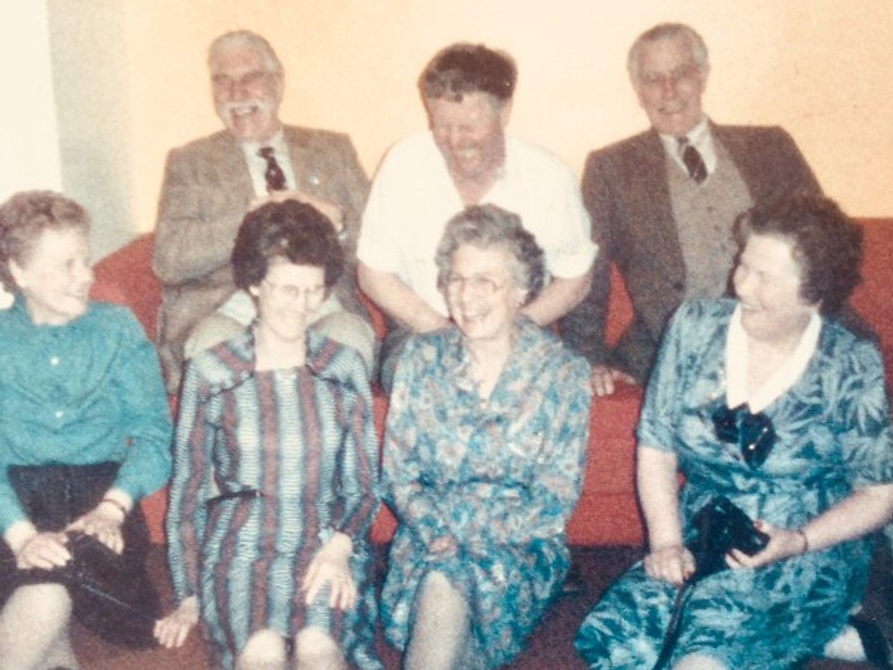 There I am (top left with the mustache, of course) with two of my brothers and four of my sisters. This was taken much later than this point in the story, but we laughed just the same.