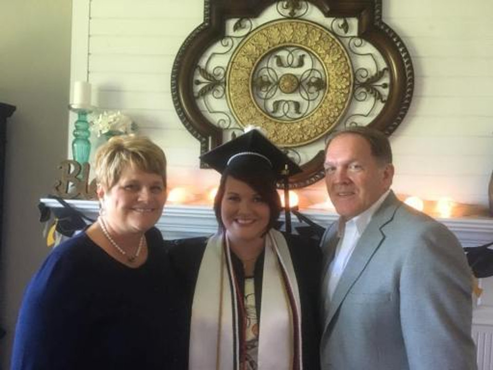 Me with my parents before my college graduation, 2017.