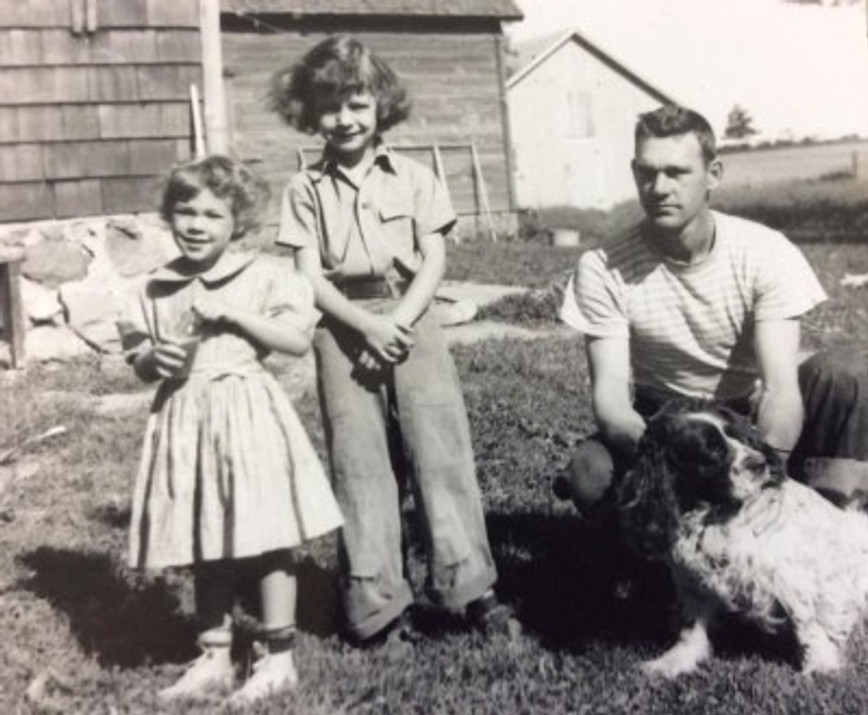 Me (far left), my cousin, my dad, and my cousins' dog Freckles, 1952.