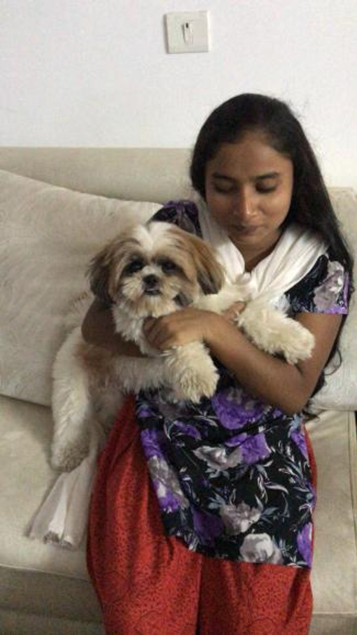 Rumsum with her family's pet.