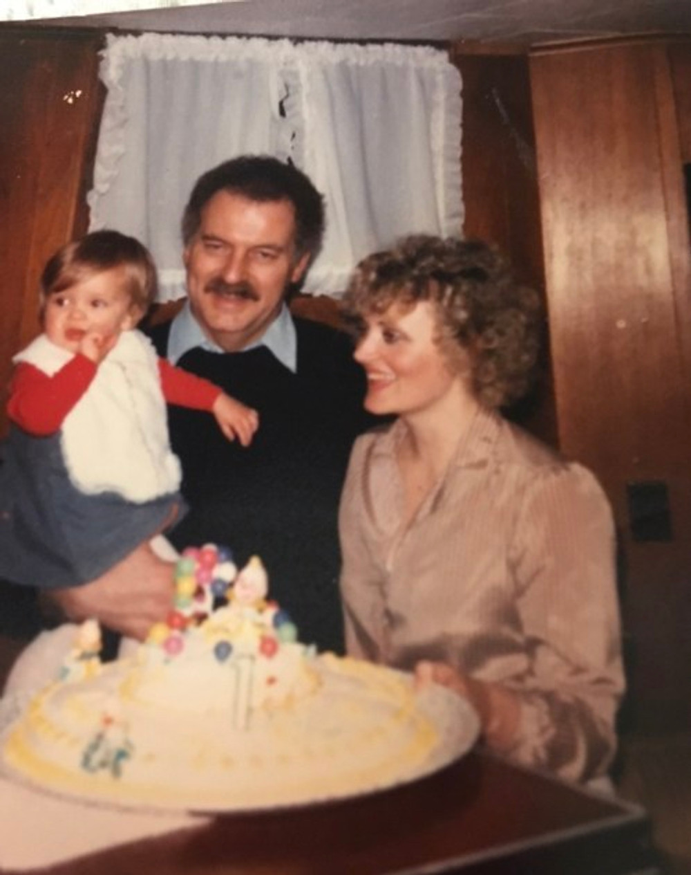 Me with my parents on my first birthday, 1983.