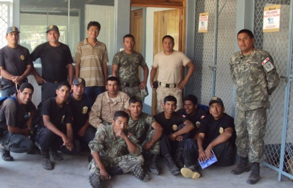 Me (third from left at the back row) surrounded by the Peruvian army and police.