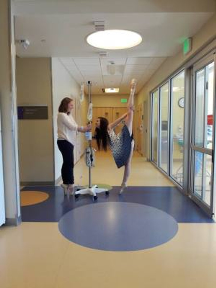 Janae and her friend Audrey dancing at the hospital.