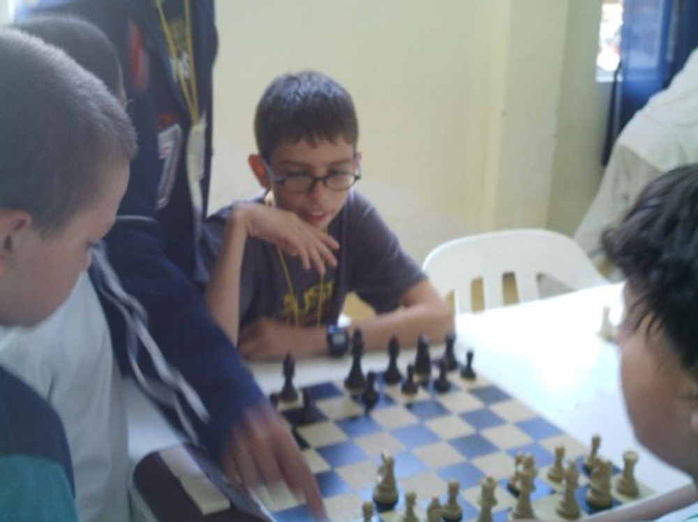 Juan playing chess at age 11.