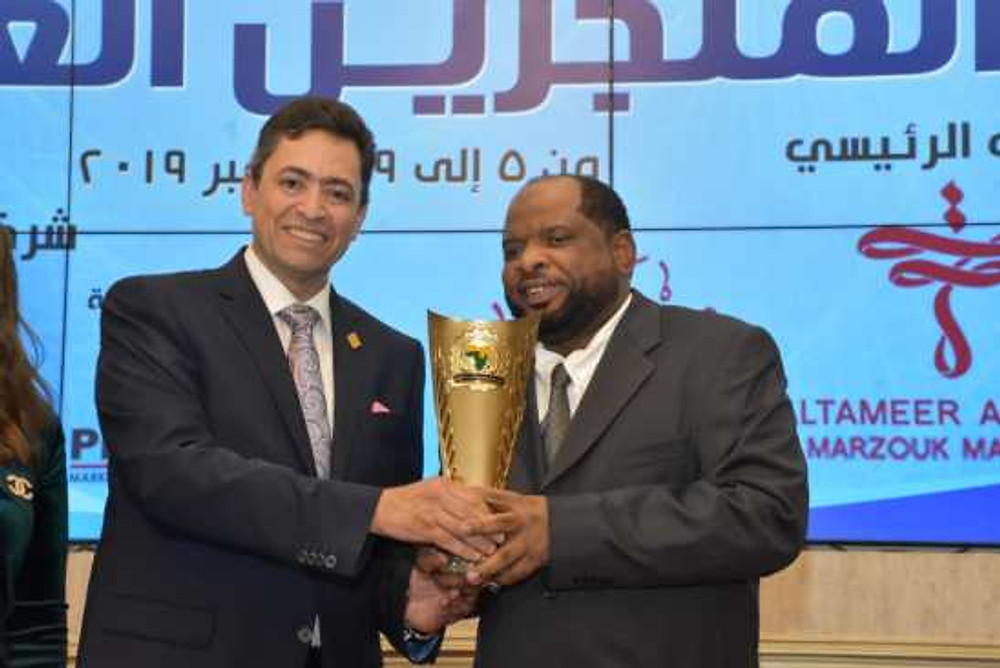 Mr. Towfik (right) receiving The United African and Arabs Achievement Award in 2019.