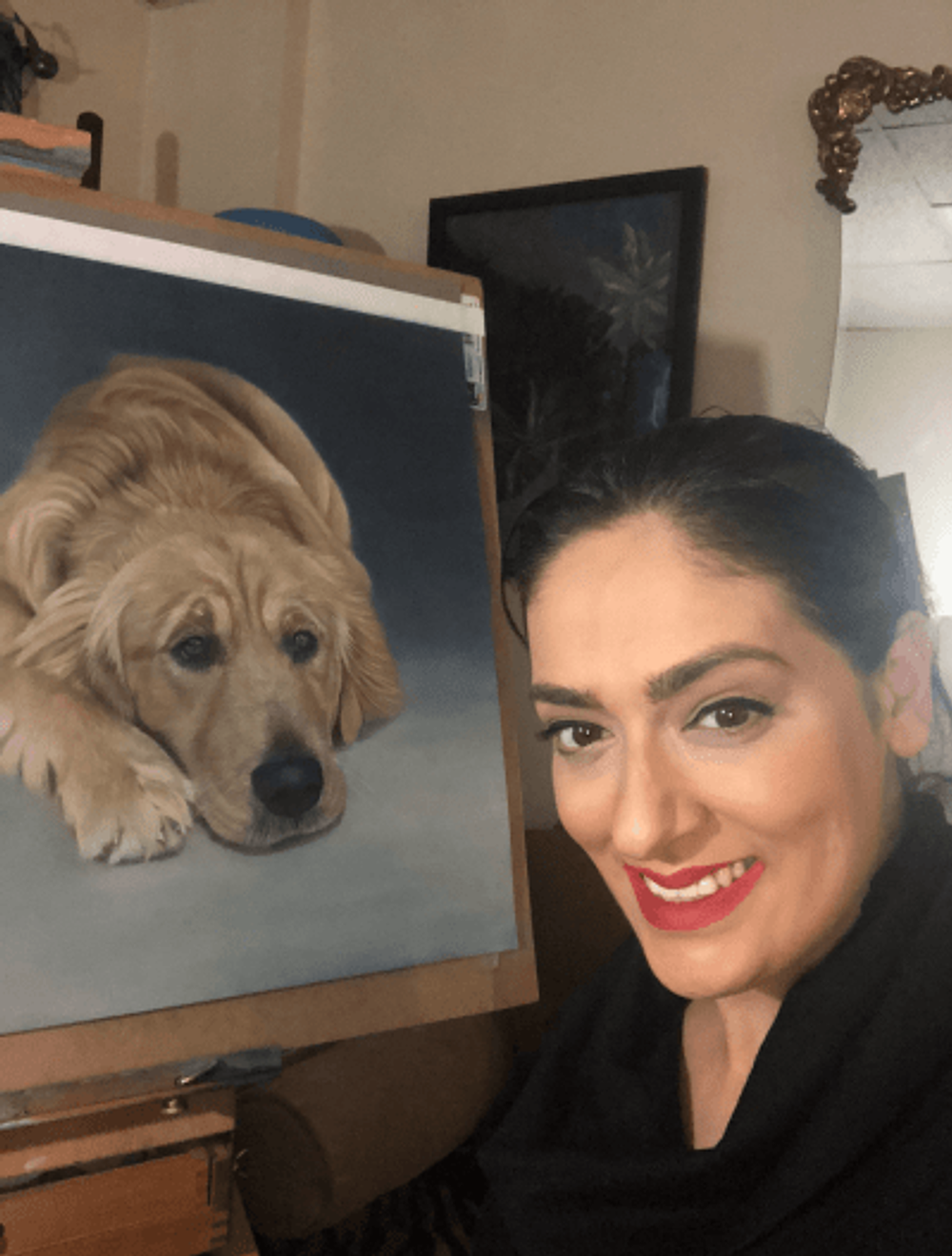 With one of the many pet paintings I've done since moving into my new apartment.