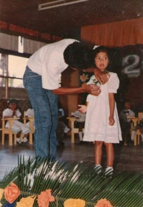My Dad pinning my ribbon for my Kinder Graduation in 1993.
