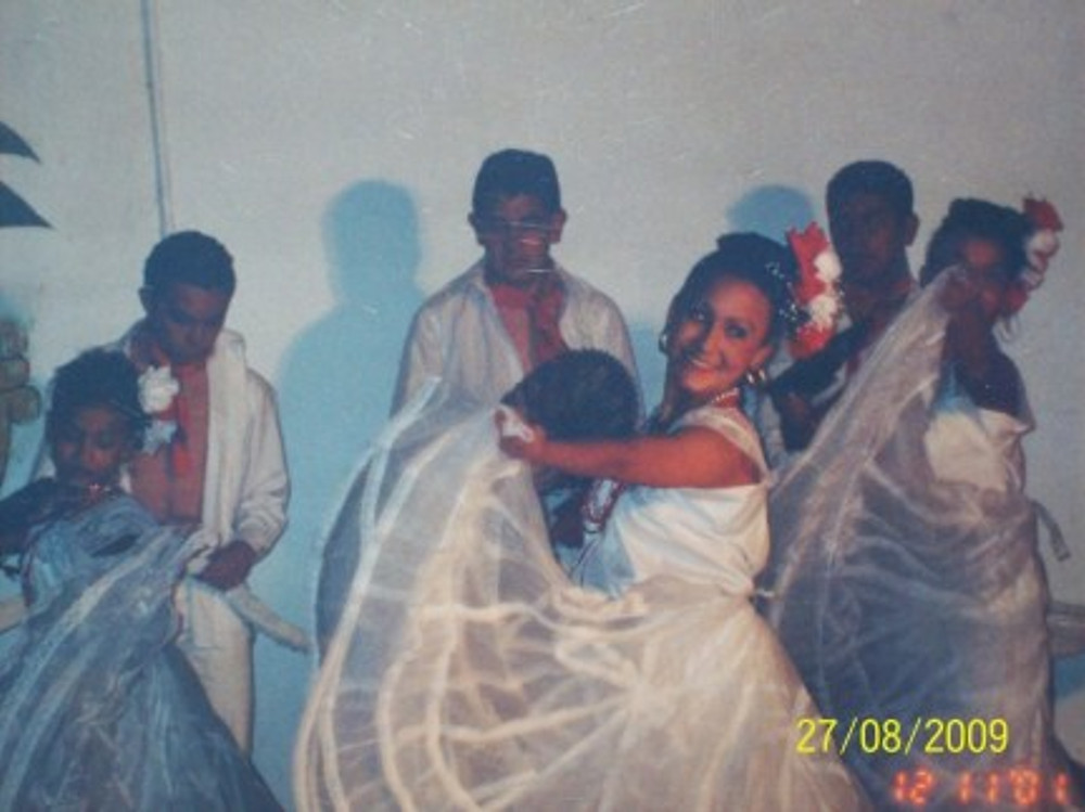 One the things I love to do is dancing. That's me (above) during a performance with a local troupe, 2001.