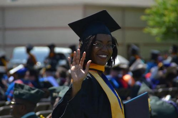 Graduating from Morgan State University.