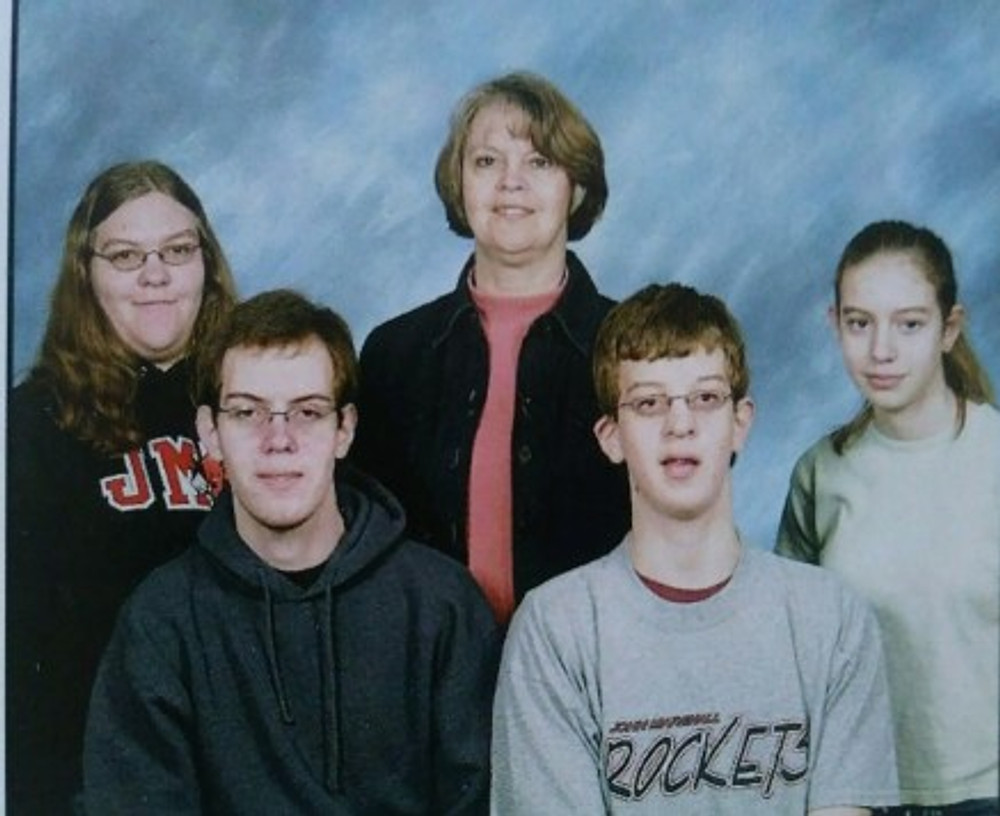 A family photo taken without Dad (I'm on the far right), 2002.
