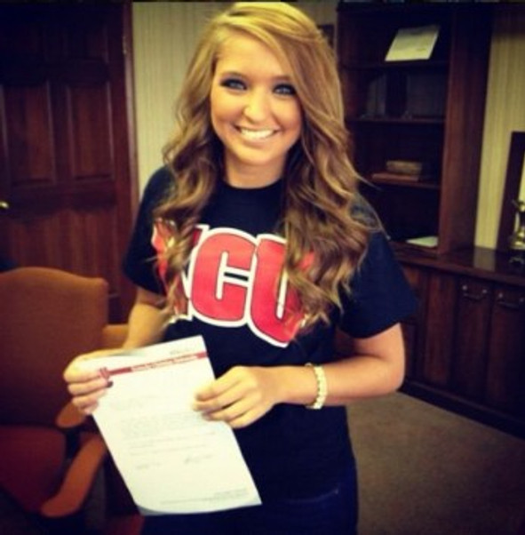 Me posing after signing with a college in 2012.