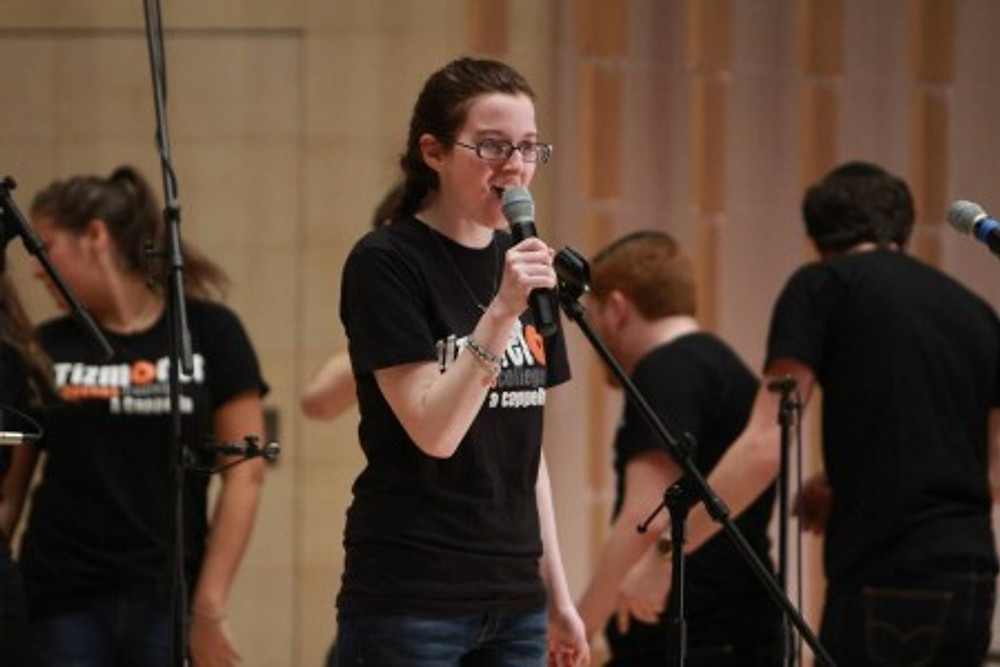 Me, singing in my a cappella group in college.