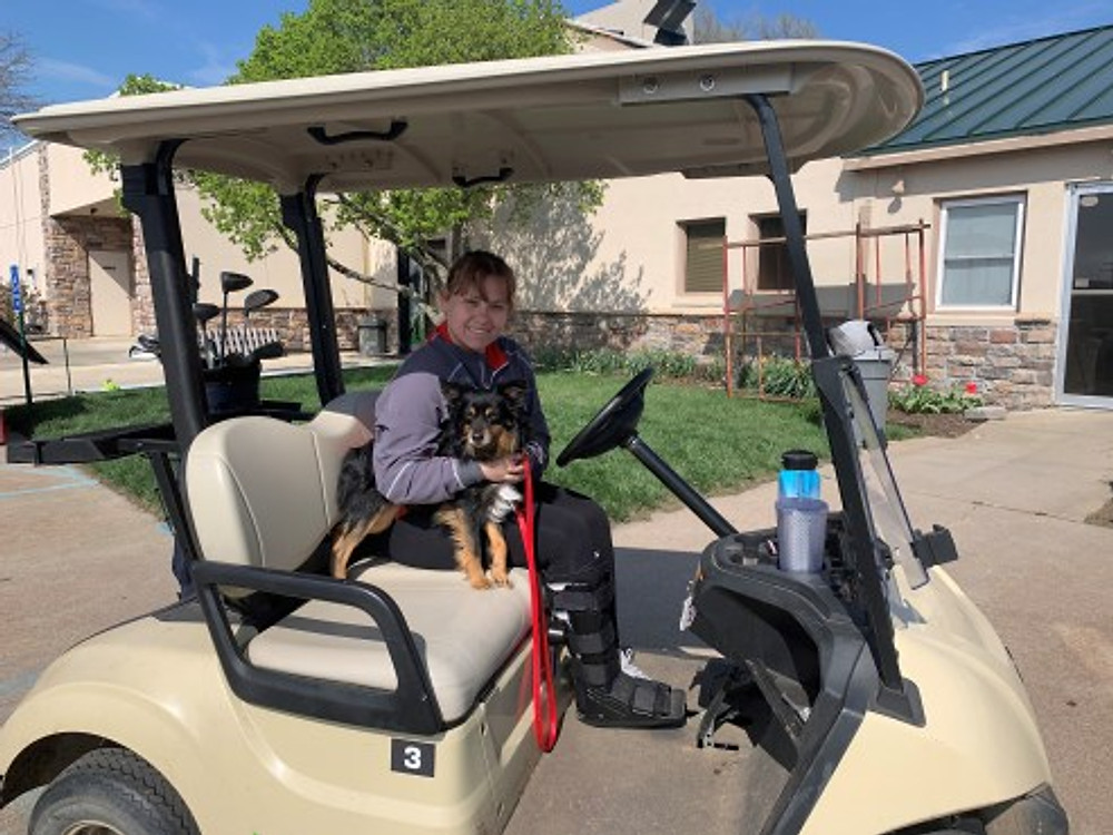 Bourbon (my favorite dog) and I are driving the cart for a day of golf, March 2020.