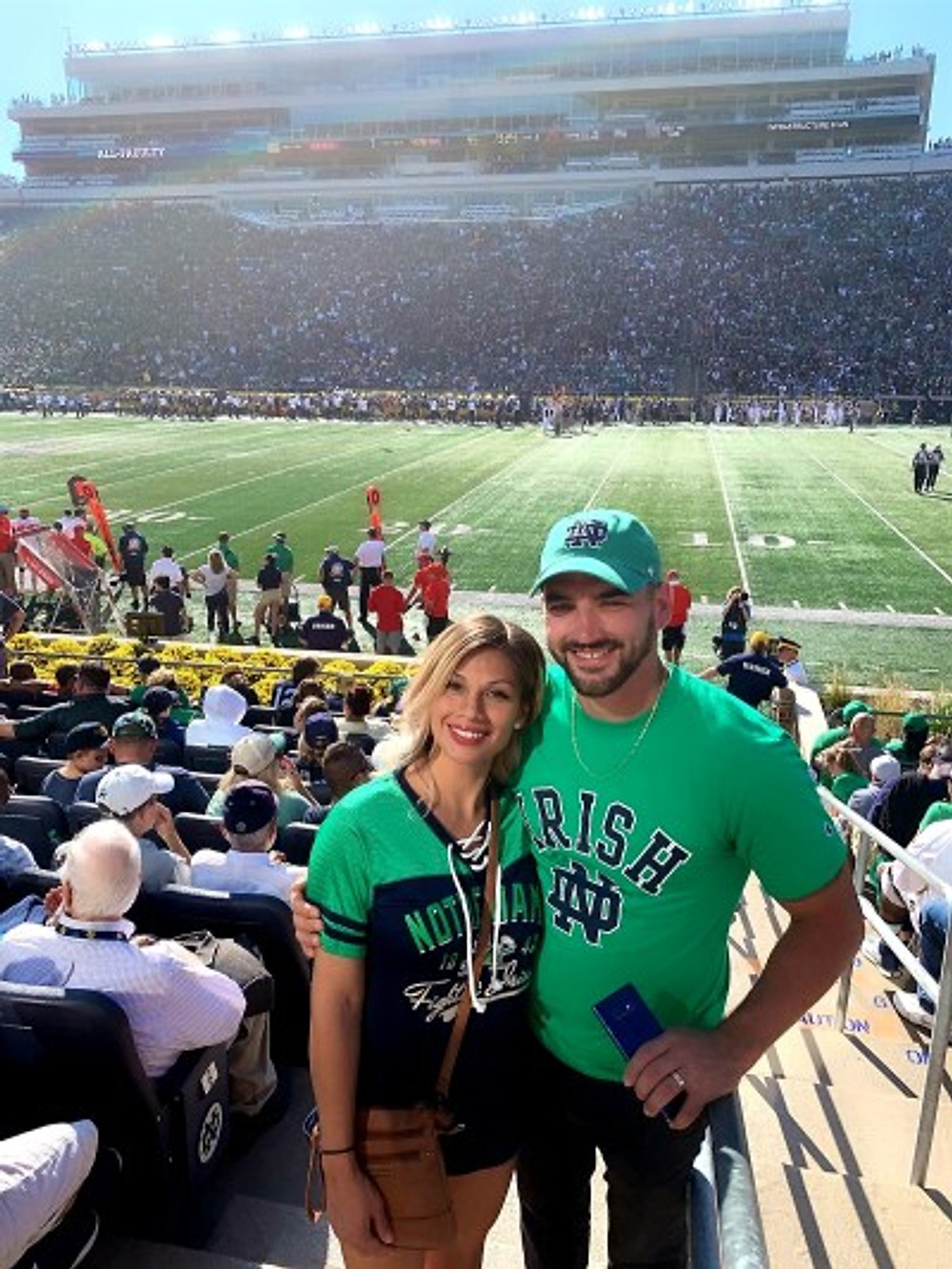 Isaac and his wife at a Notre Dame football game.