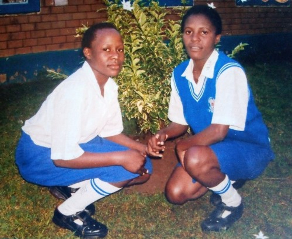 Me (left) and my friend Linda at Ndivisi Girls High School.